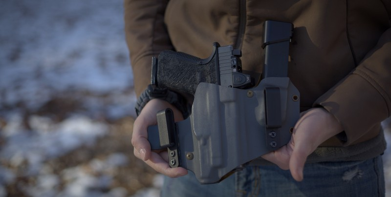 Shown is one of our Sidecar appendix rigs. An effective way to carry a handgun with a weapon light equipped