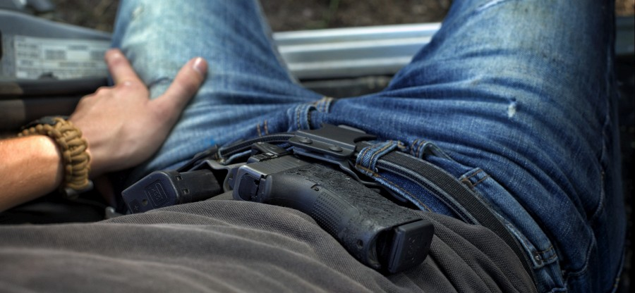 Raptor holster with a Micro Mag Carrier being worn IWB