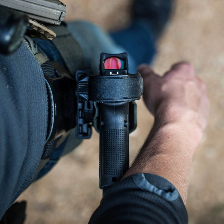 "The Titan fits slide-mounted optics like this Trijicon RMR just fine."" width=""900"" height=""1125"" /> The Titan fits slide-mounted optics like this Trijicon RMR just fine."