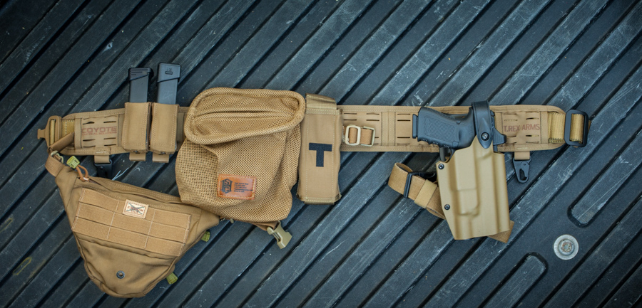 Coyote brown Orion with a Emdom USA pack weaved through, Titan holster, and assorted pouches