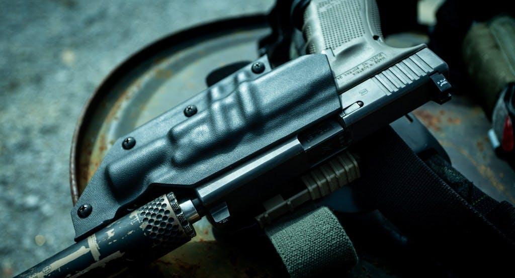 Glock 19 with Trijicon Suppressor sights and Gemtech Tundra